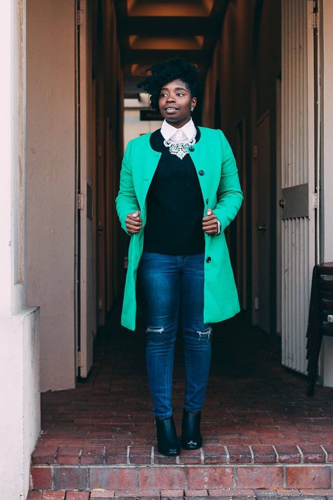 styling black sweatshirt with a green peacoat